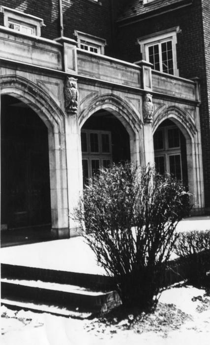 Carved limestone owls on the exterior of the Wabash College chapter house.