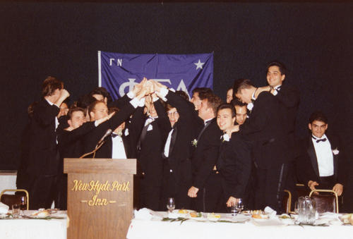 Adelphi University brothers at head table at chartering.