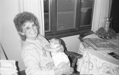 "Woman with baby - University of Akron's ""Traditions of Excellence"" during Summer 1989."