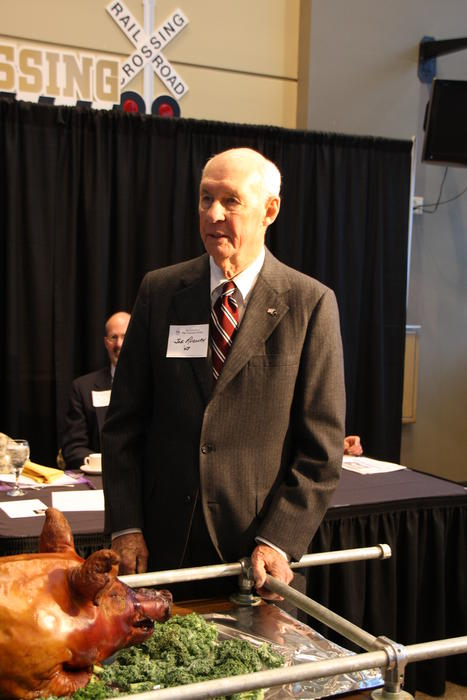 Oldest graduate in attendance at the dinner, Joe Rudolph (Purdue 1948). Purdue University Pig Dinner on February 25, 2012.  Keynote speaker was Brian Lamb (Purdue 1963).  Brian Lamb was founder, CEO and Host on US television station C-SPAN.