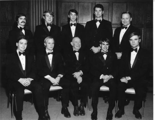 "Ritual Team and directors: (seated left to right) Phillip Heyde (DePauw University 1972), Charles W. Aldous (Hanover College 1972), John Scott (Indiana University 1972) legate, Donald A. Lesch (Indiana University 1972), Frederick C. Franzwa (Rose-Hulman 1972), standing left to right: Reginald George (Indiana University 1972), Douglas Moore (Indiana University 1972), Steven C. Goble (Rose-Hulman 1971), J. Michael Cota (Purdue University 1972), Louis A. ""Bud"" Mangels (Indiana University 1956) Phi Gamma Delta Ritualist"