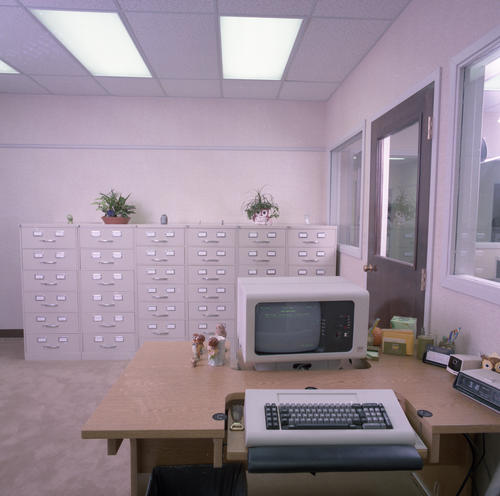 New International Headquarters Building and Staff in July 1985. The building was dedicated on May 18, 1985.  Pictured is a computer terminal and file system.