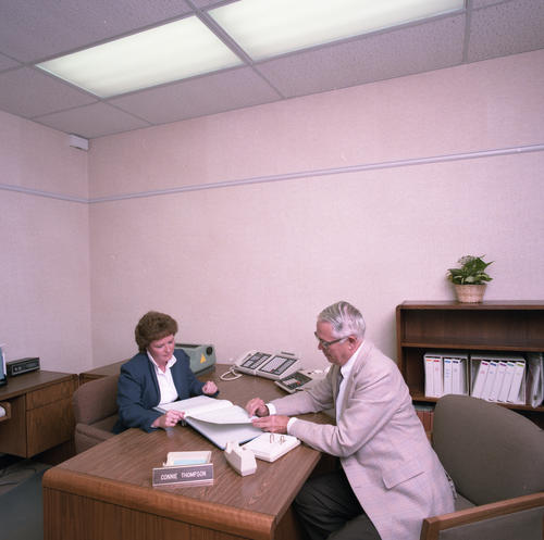 New International Headquarters Building in July 1985. The building was dedicated on May 18, 1985.  Bill Zerman (University of Michigan 1949) with Connie Thompson at desk.