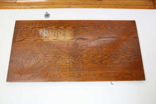 Carved desktop located in Indiana University Chapter House taken on August 3, 2013.
