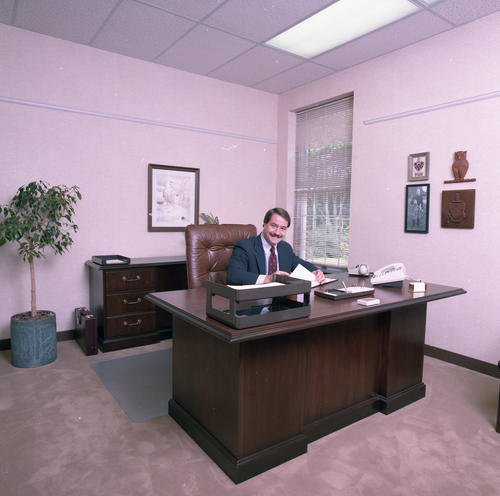 "New International Headquarters Building in July 1985. The building was dedicated on May 18, 1985.  Eugene ""Buddy"" Cote (University of Maine 1981) at his desk.  Eugene ""Buddy"" Cote (University of Maine 1981) service to Phi Gamma Delta:  Field Secretary - 1981-1983 Director of Chapter Services - 1983-1985 Archon Counsilor - 2000-2002 Archon Secretary - 2002-2004 Archon President - 2006-2008 Chairman, Boston Ekklesia Host Committee, 2016"