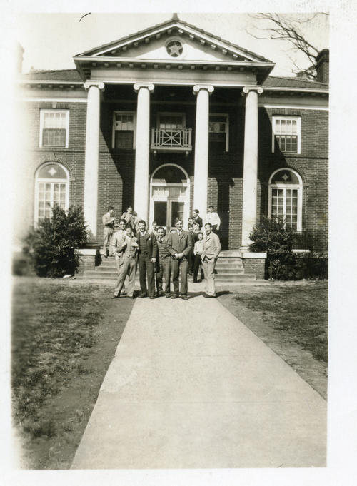 Brothers posing in front of the University of Alabama chapter house